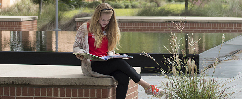 USA Student Studying outside the Campus Rec Center